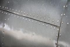 Detail of old grunge piece of aircraft. For metal background stock images