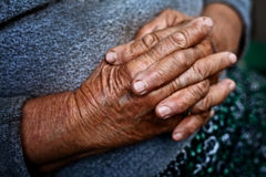 Detail on old hands of senior wrinkled woman Stock Images