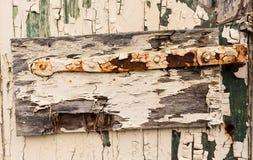 Detail of old hinge on wooden door Stock Photos