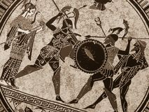 Detail from an old historical greek paint over a dish. Mythical heroes and gods fighting on it stock photography
