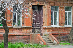 Detail of old house. Outdated 18th-century house in the city block to be demolished Royalty Free Stock Images