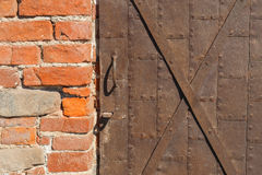 Detail of old iron door and brick wall Stock Image