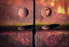 Detail of an old iron fencing riveted joints Stock Photos