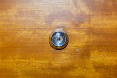 Charming Detail Of Old Lens Peephole On Wooden Door Background, For Secur Stock  Photos
