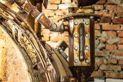 Detail old machinery. Rusted liquid meter of an ancient machine in a abandoned factory royalty free stock photography