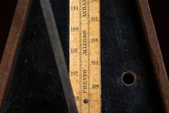 Detail of an old mechanic musical metronome royalty free stock photography