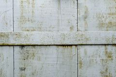 Detail of old metal doors reinforced with steel bands Stock Photo