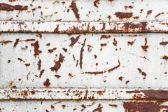 Detail of the old metal surface with sections of corrosion, rust and cracked paint, white color Royalty Free Stock Images