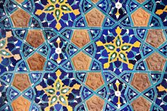 Detail of old mosaic wall with traditional georgian floral pattern. With clay and ceramic details of red, yellow and blue colors stock photos