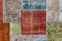 Detail of a old patchwork carpet Stock Photo