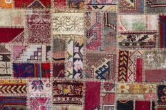 Detail of a old patchwork carpet . Close up Stock Image