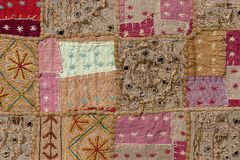 Detail of a old patchwork carpet Royalty Free Stock Photo