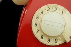 Detail of old phone. Vintage red telephone with dial close up Royalty Free Stock Photography