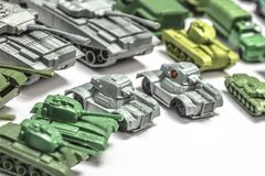 Plastic tank toys. Detail of old plastic toys, reproductions of military weapons such as jeeps and armored tanks royalty free stock photography