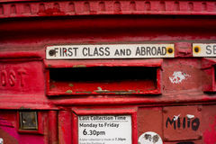 Detail of Old Red London Letterbox. London red letterbox for first class and abroad mail, London, UK Stock Images