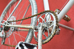 Detail of old road bike - crankset, pedal. On colorful red background. Shallow depth of field stock photos
