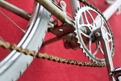 Detail of old road bike - crankset, pedal. On colorful red background. Shallow depth of field royalty free stock photo