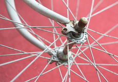 Detail of old road bike - front wheel. On colorful red background. Shallow depth of field stock images