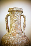 Detail of an old roman amphora - toned image Italy Stock Image