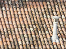 Detail of old roofing with chimney. royalty free stock image