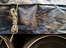 Old rope loop and dirty old canvas covered truck on truck for transportation background Royalty Free Stock Photo