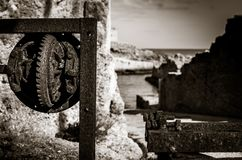 Detail of an old rusty device along the sea royalty free stock photo