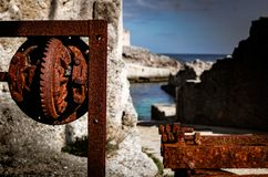 Detail of an old rusty device along the sea stock photo