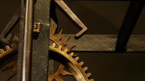 Old clock mechanism with gears.