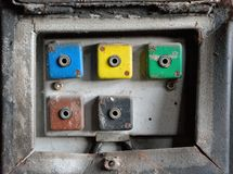 Detail of an old rusty machine, factory. Detail of an old rusty machine with coulered buttons, factory Stock Photography