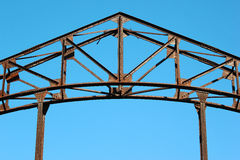Detail of old rusty metal bridge on blue sky background Stock Image