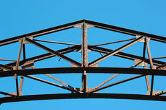 Detail of old rusty metal bridge on blue sky background Royalty Free Stock Photo