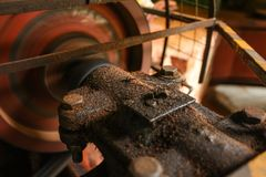 Detail on old rusty motor mechanism, rotor moving, metal axis co royalty free stock images