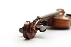 Detail of old scratched violin on white background Royalty Free Stock Photo