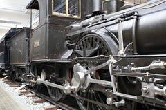 Detail of old steam locomotive. Closeup of vintage steam engine's black, iron wheel Stock Photos
