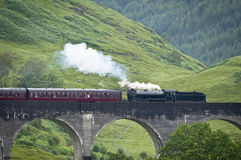Detail of an old steam train crossing an old viaduct Stock Photography