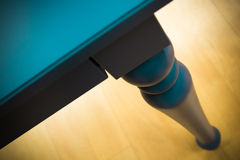 Detail of an old style blue table leg Royalty Free Stock Photos