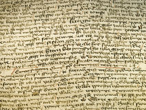Detail of the old text. Close-up of the medieval hand written script Royalty Free Stock Photos