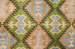 Detail of old traditional romanian wool carpet. With ancient motifs Stock Photos