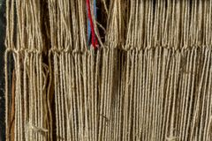 Detail of old traditional weaving loom and shuttle on the warp. Weaving loom for homemade on vintage background. Stock Image