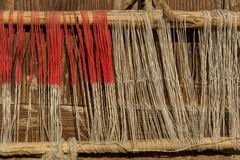 Detail of old traditional weaving loom and shuttle on the warp. Weaving loom for homemade on vintage background. Royalty Free Stock Photo