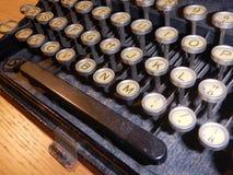 Detail of an old type writer keyboard. A detail of an old type writer keyboard Royalty Free Stock Image