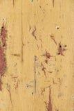 Detail of old vintage door in orange color Royalty Free Stock Images