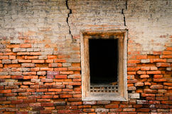 Detail of old weathered brick wall and window Royalty Free Stock Image
