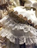 Detail of an old wedding dress in ivory color with floral decora. Tions with gold wire royalty free stock image