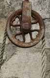 Detail of an old well pulley. With heart shape spokes Stock Photography