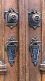 Detail of an old wooden door with bronze handles and locks. Salzburg. Austria stock photography