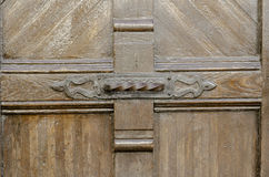 Detail old wooden door with forged iron ornament. Stock Photography