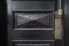 Detail of old wooden door, lock and handle. Detail of old wooden door, decorative element, lock and handle Stock Photography