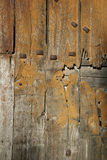 Detail Of Old Wooden Door. With rusted metal mechanism Royalty Free Stock Photo