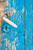 Detail of old wooden teal door and metal door handle stock photos
